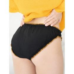 Braga menstrual negra primer plano